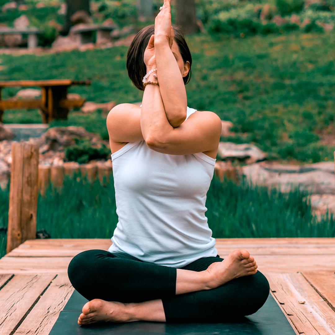 Woman practicing yoga on a yoga matt
