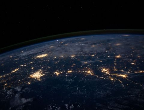 view of the earth at night from out of space