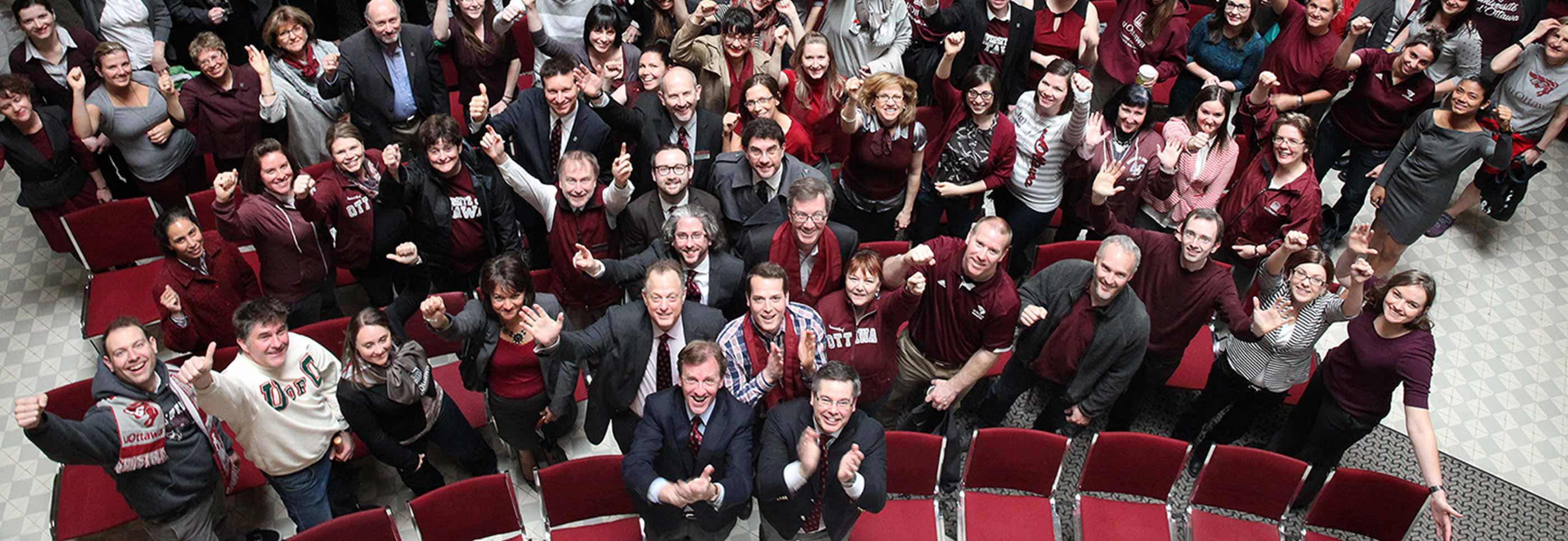 Photo of large group of alumni dressed in garnet and grey clothing.