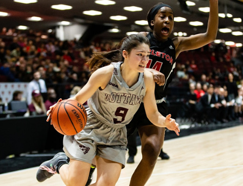 Gee-Gees basketball player dribbling to get around a player of the opposing team