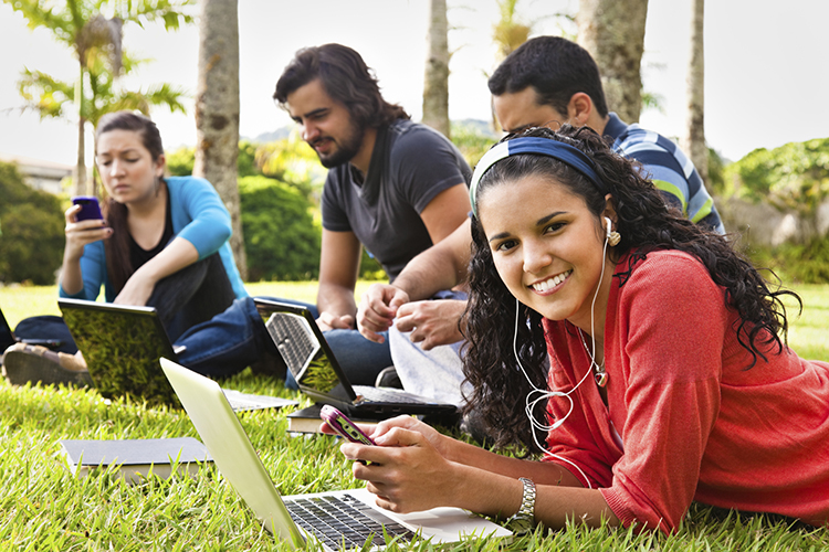 3.Image of 4 students in front of their laptops: