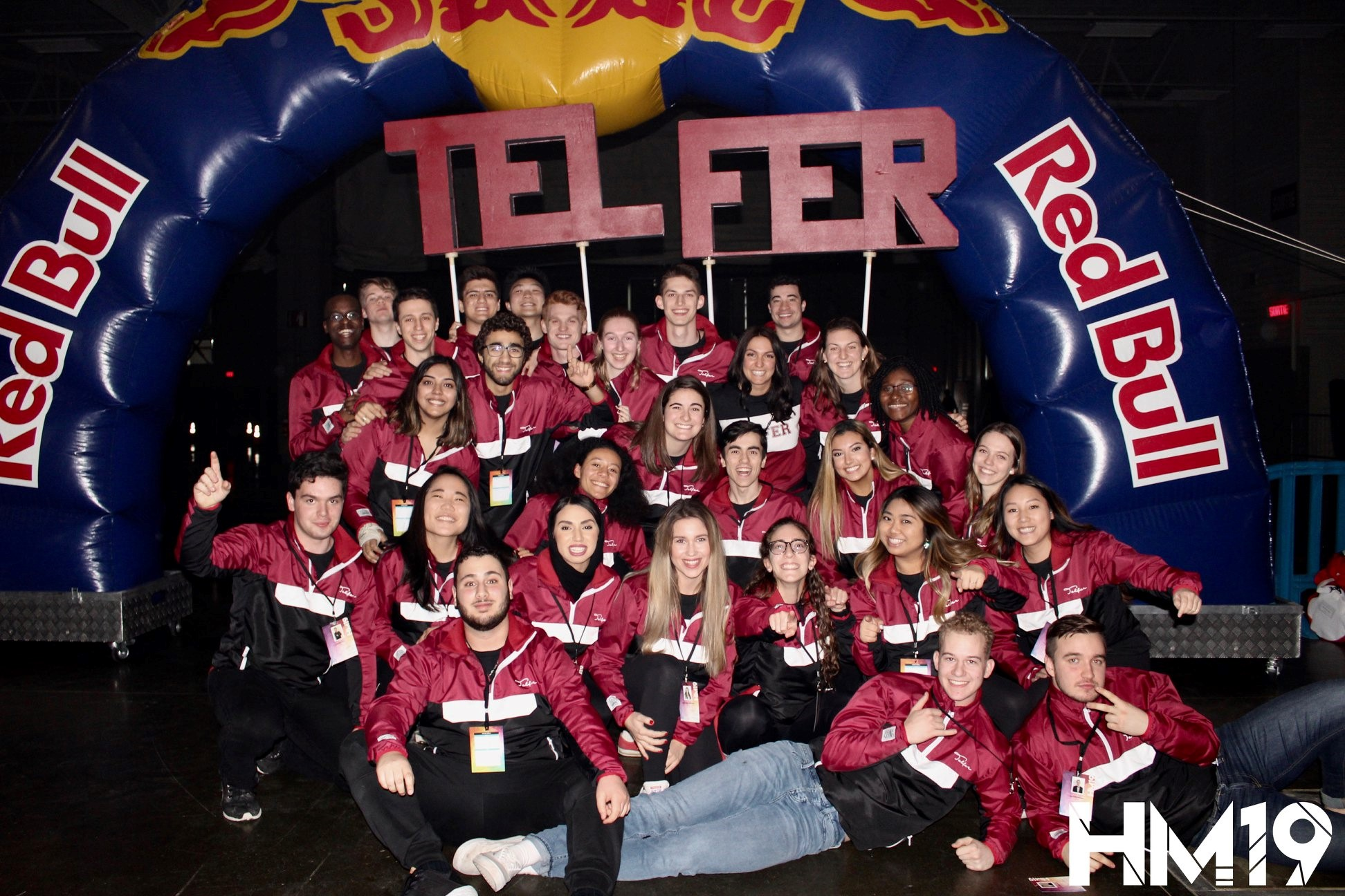 Group of students under a RedBull arch with Telfer name.