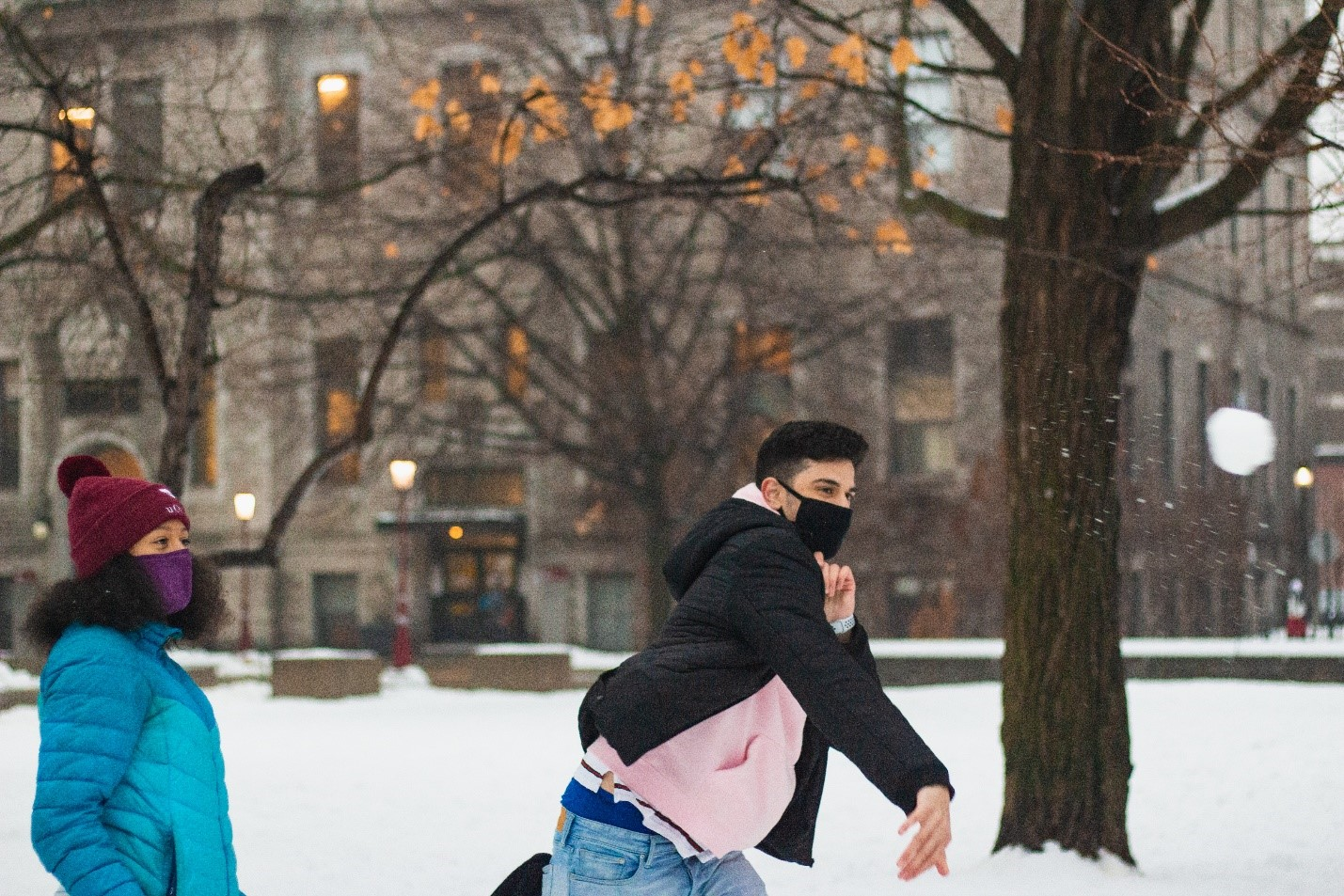 Two people throwing snow balls.