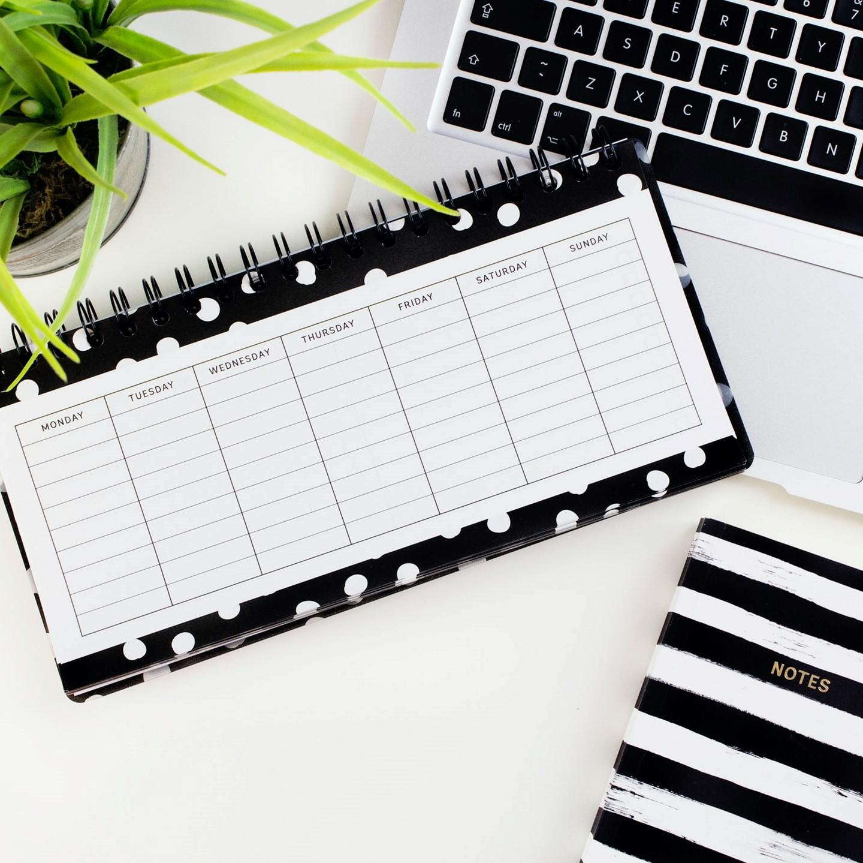 Laptop, calendar and agenda
