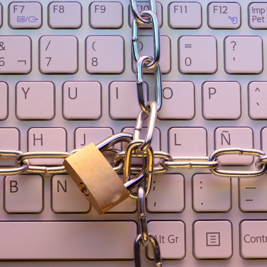 Lock and chains around a keyboard