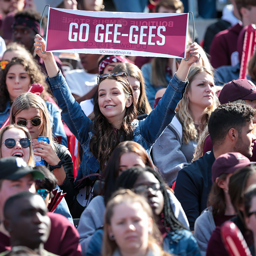 Student cheering for the gee-gees