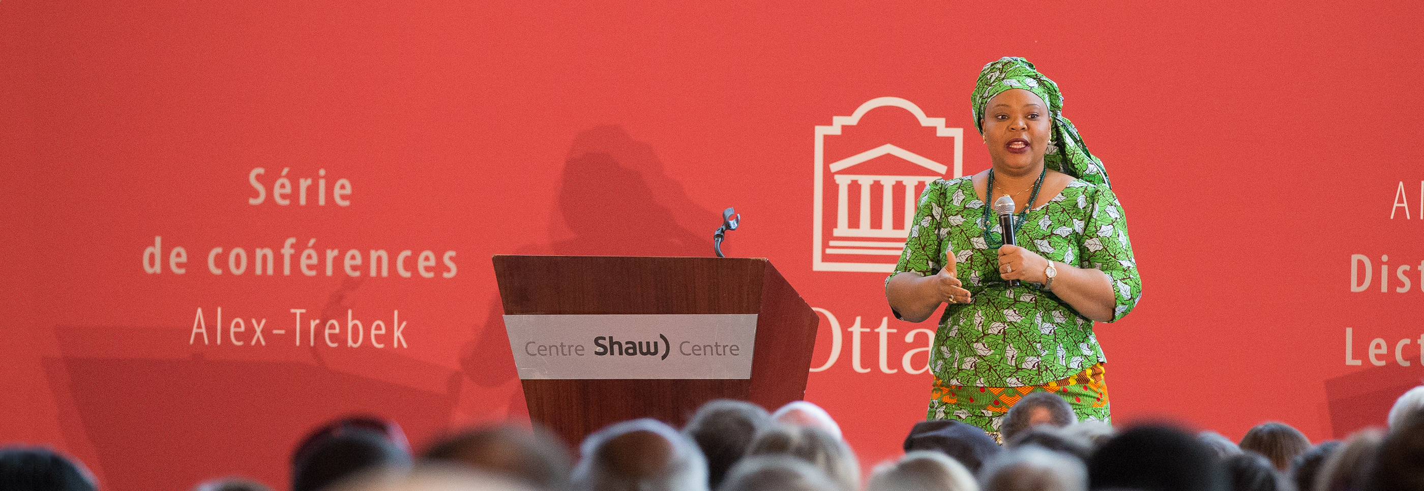 Leymah Gbowee on stage in front of a crowd at the Alex Trebek Distinguished Lecture Series
