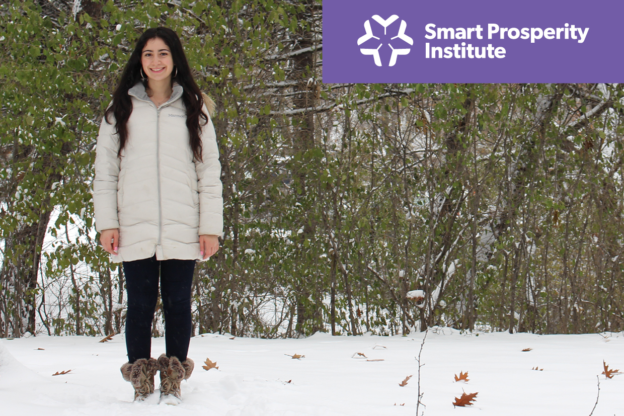 Smiling students stands in a tree grove in winter