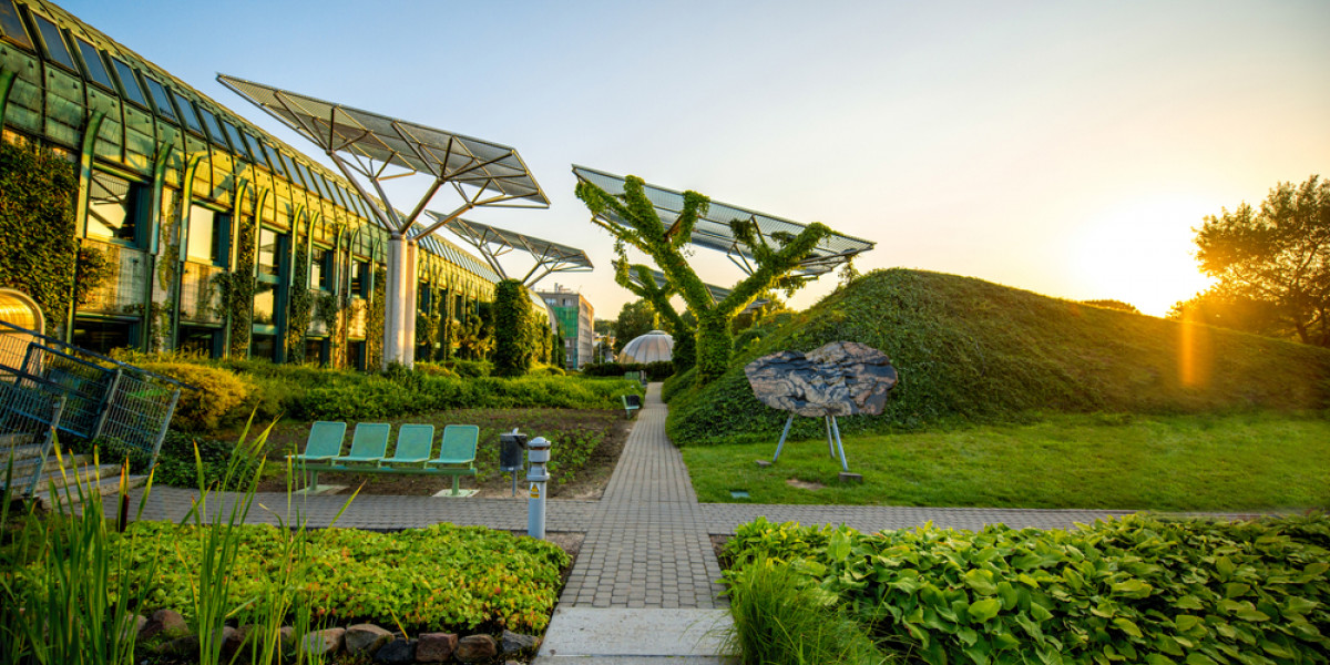 Sun rises over green landscape with solar panels, sense of possibility and hope
