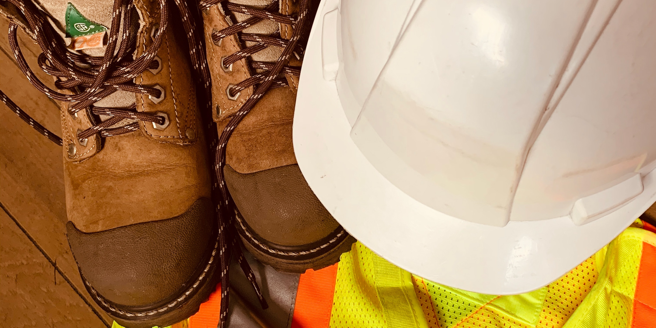 Picture of a hard hat, safety vest and safety boots