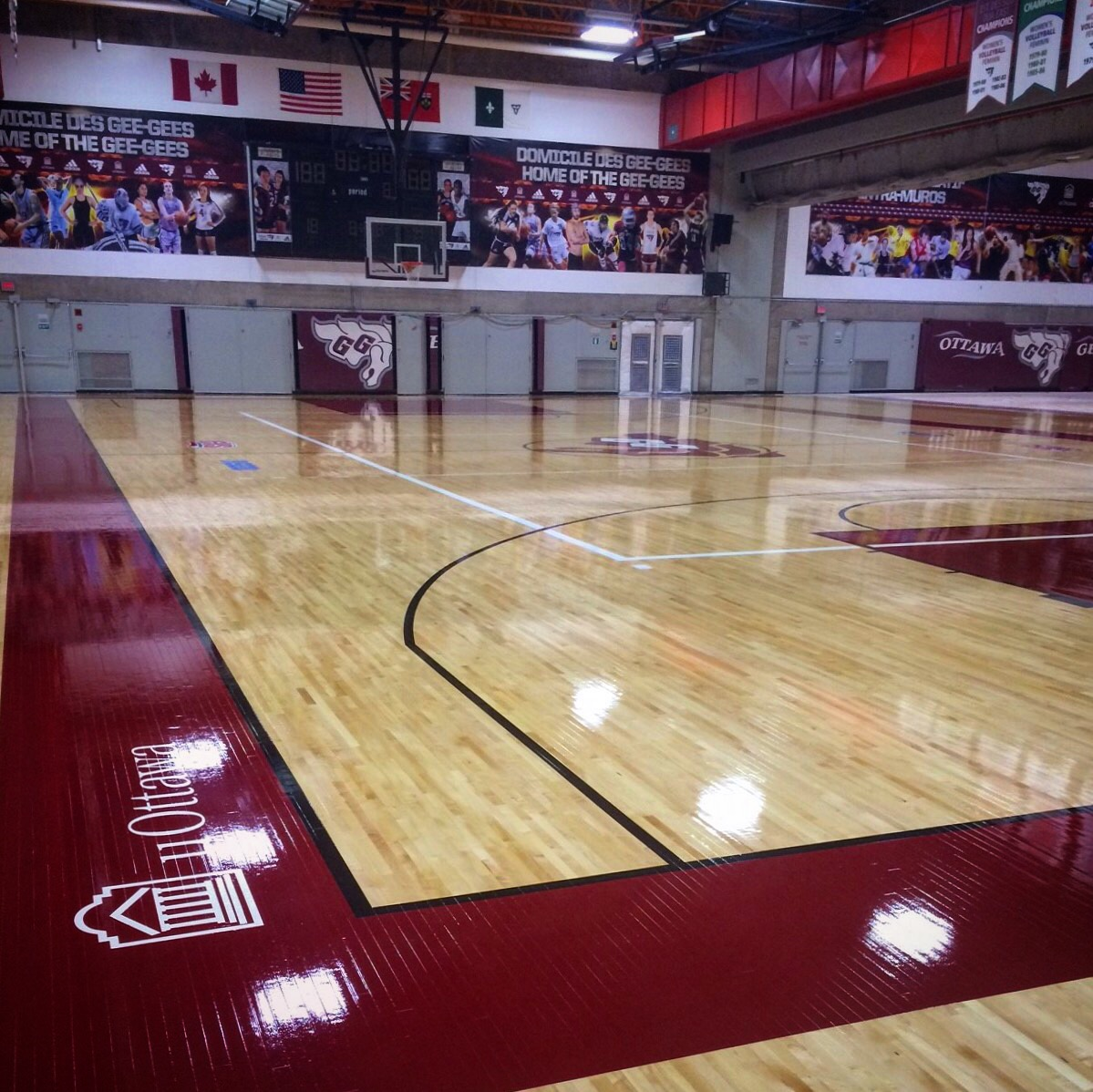 The freshly sanded and waxed floor of the Montpetit gym