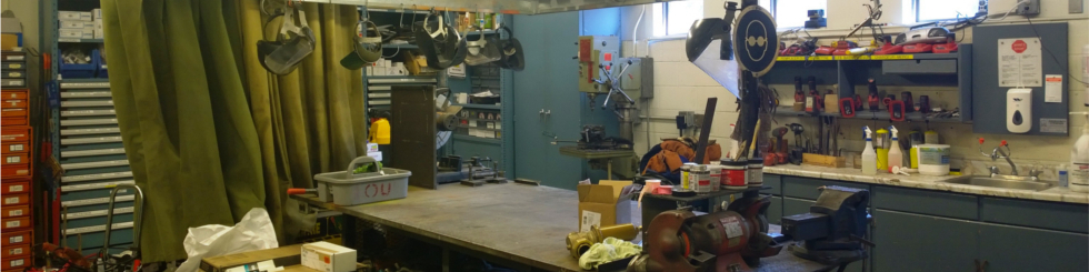 A banner image showing the inside of the plumber's workshop