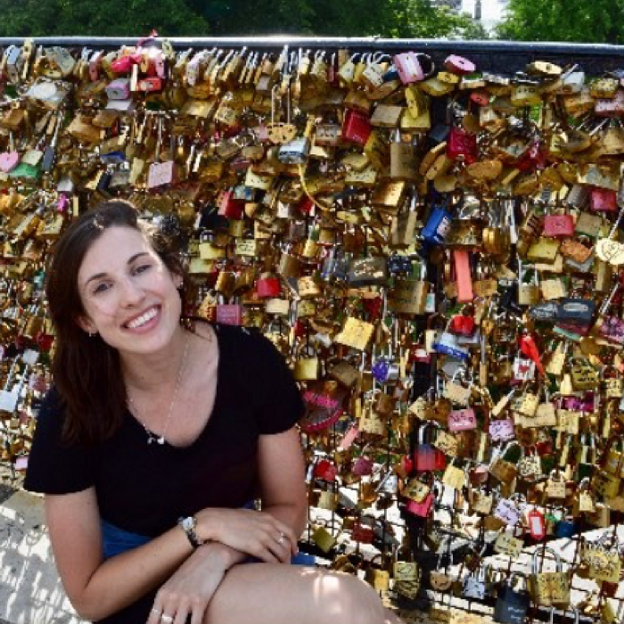 michdolla in front of a bridge covered in love locks