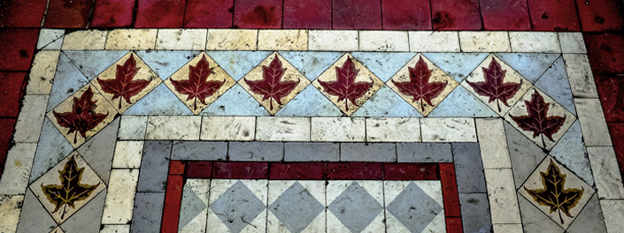 A colourful mosaic of tiles that includes diamonds and maple leafs at uOttawa.