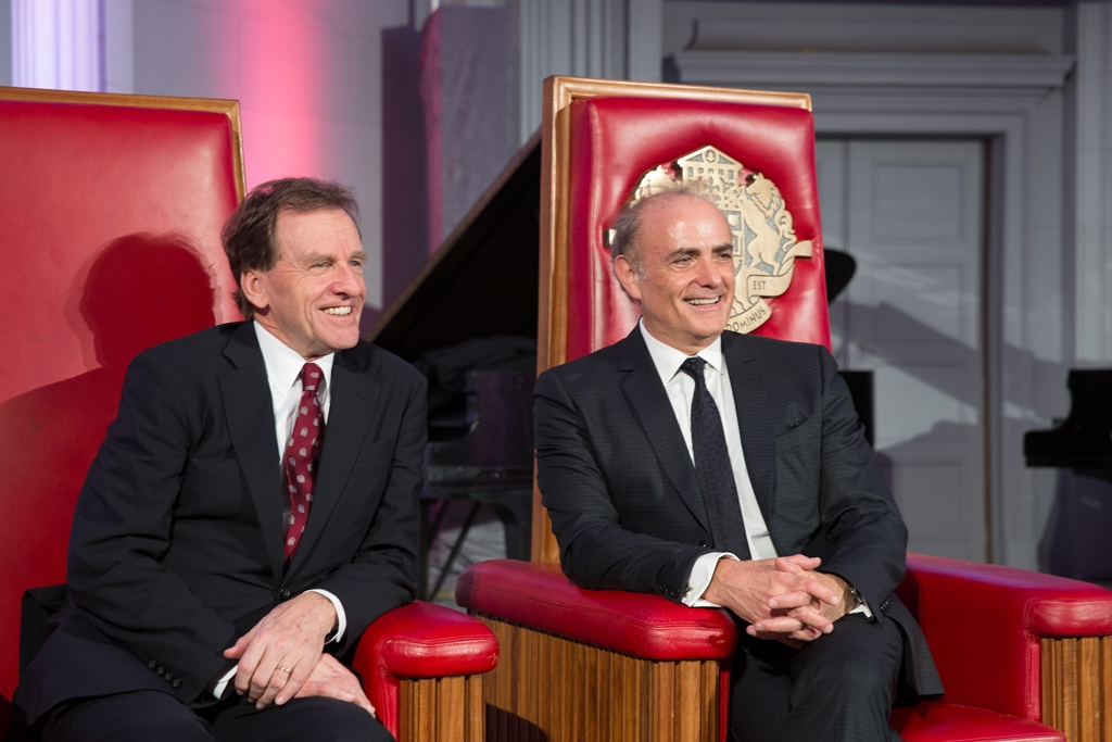 Allan Rock and Calin Rovinescu sitting on chairs.