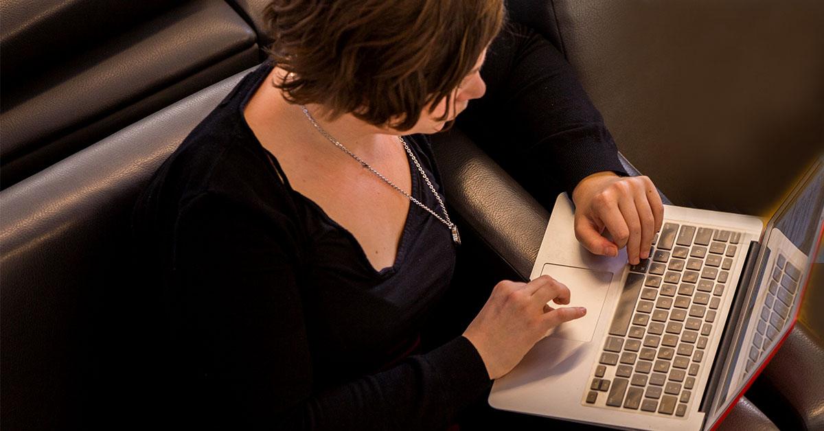 image of woman typing on laptop keyboard