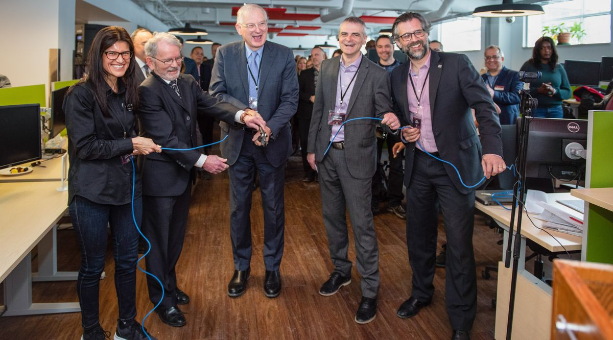 Jacques Frémont with IT staff at the inauguration of the new workspace.