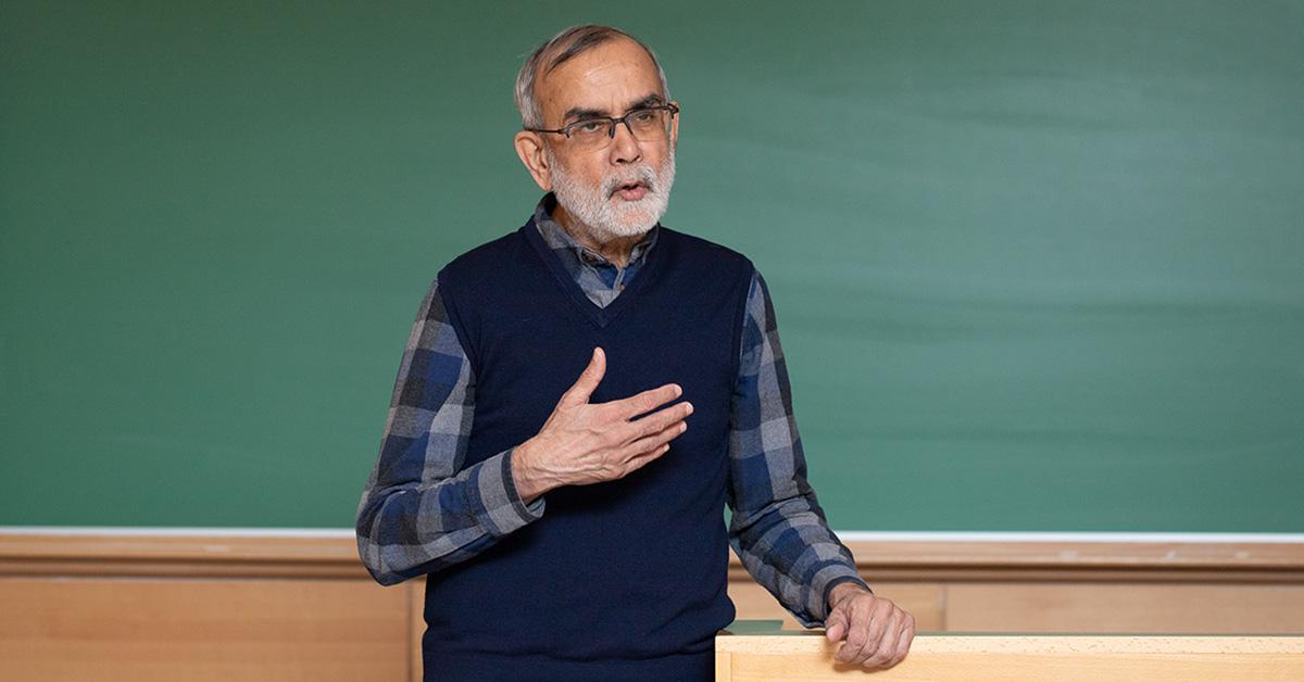 Professor Fayyaz Baqir in front of a classroom