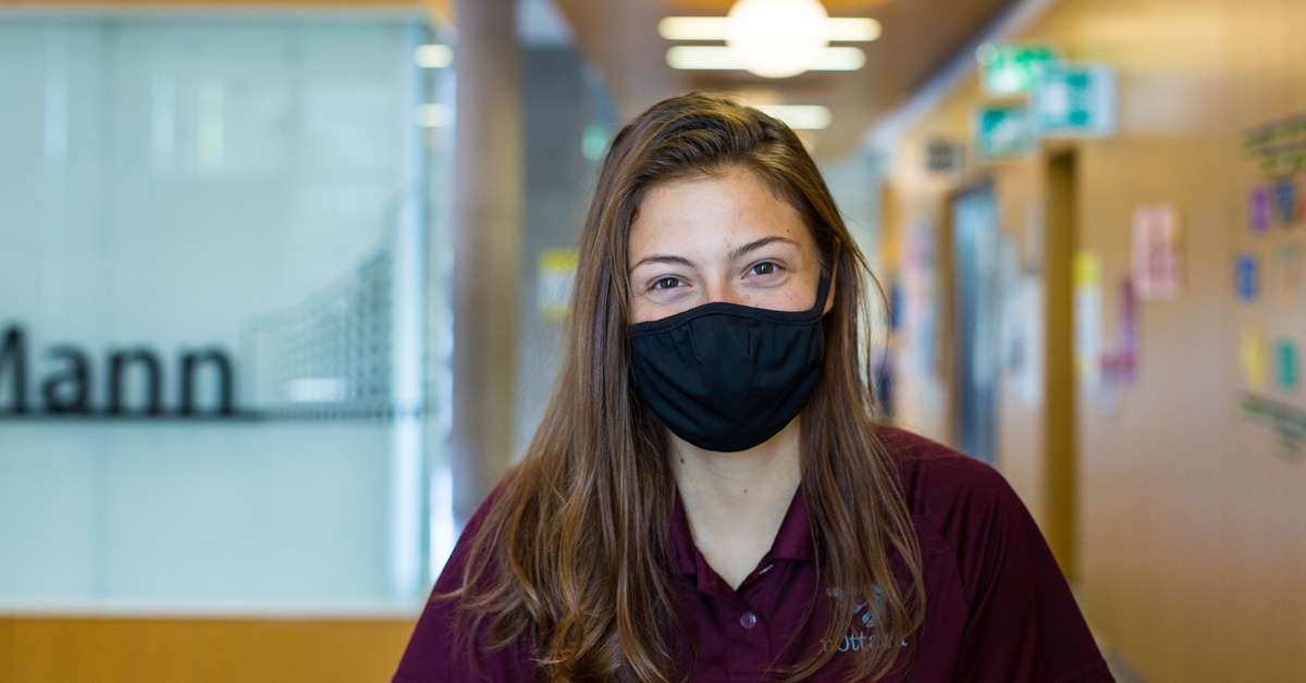 A person wearing a cloth non-medical mask