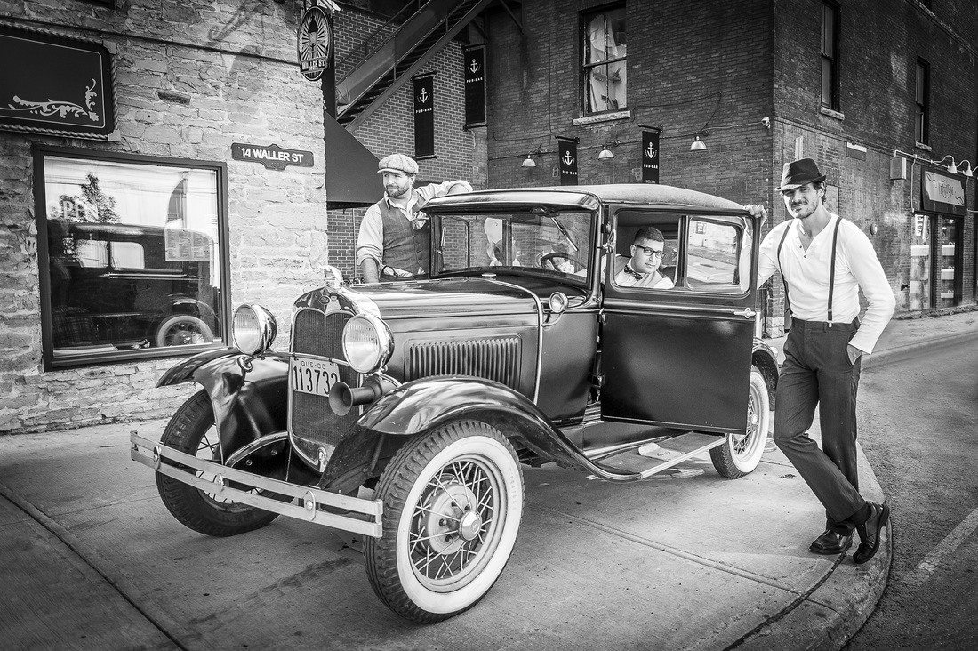 Owners of the brewery posing with a car. Photo looks like it was taken in 1930.