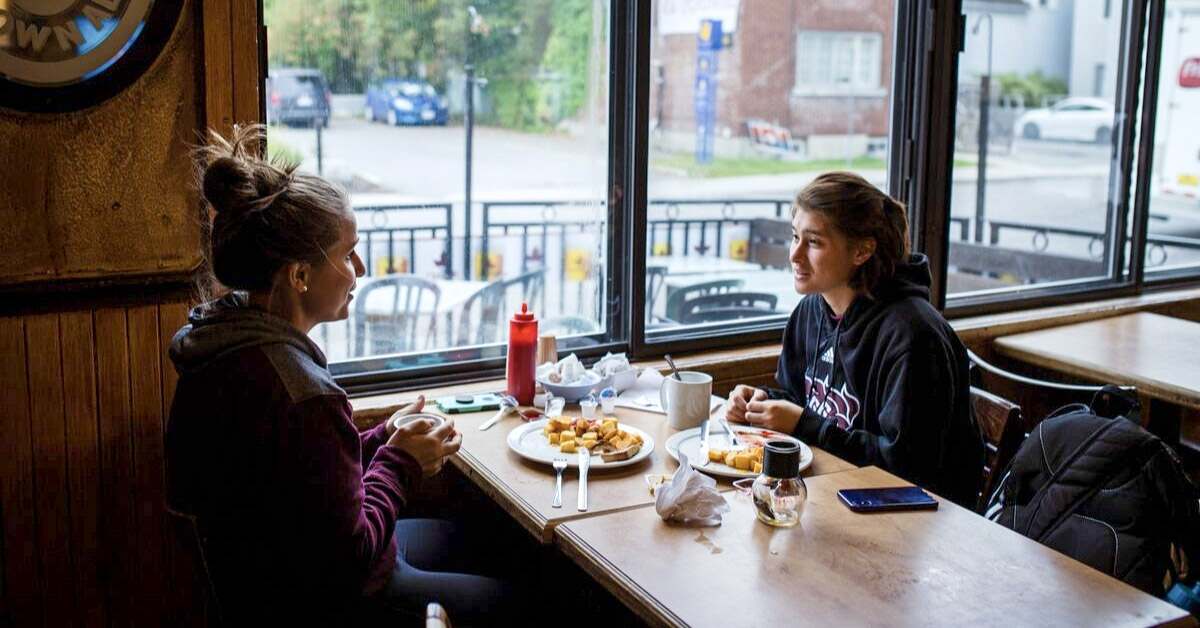 Two students eating breakfast at Father and Sons restaurant.