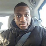 Selfie of davidnku sitting in the driver's seat of a car