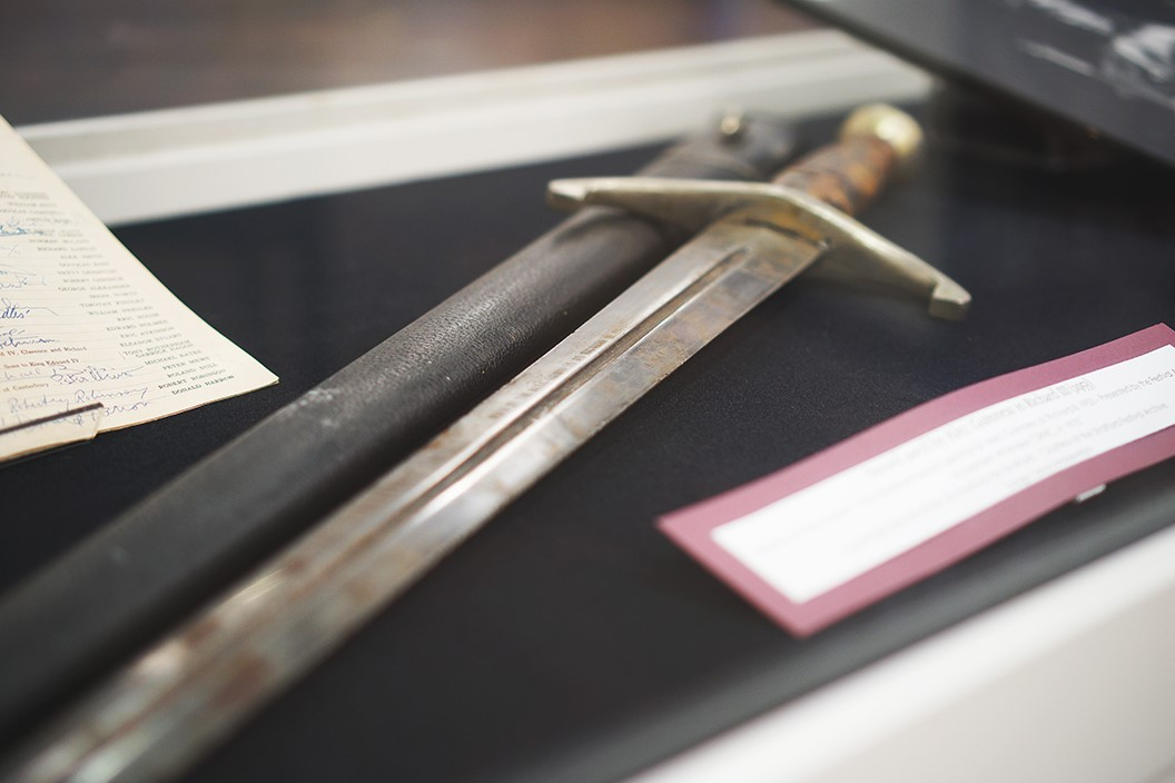 A sword and its sheath in a display case.