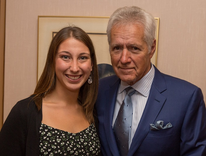 Hunter Kelly, smiling, with Alex Trebek.