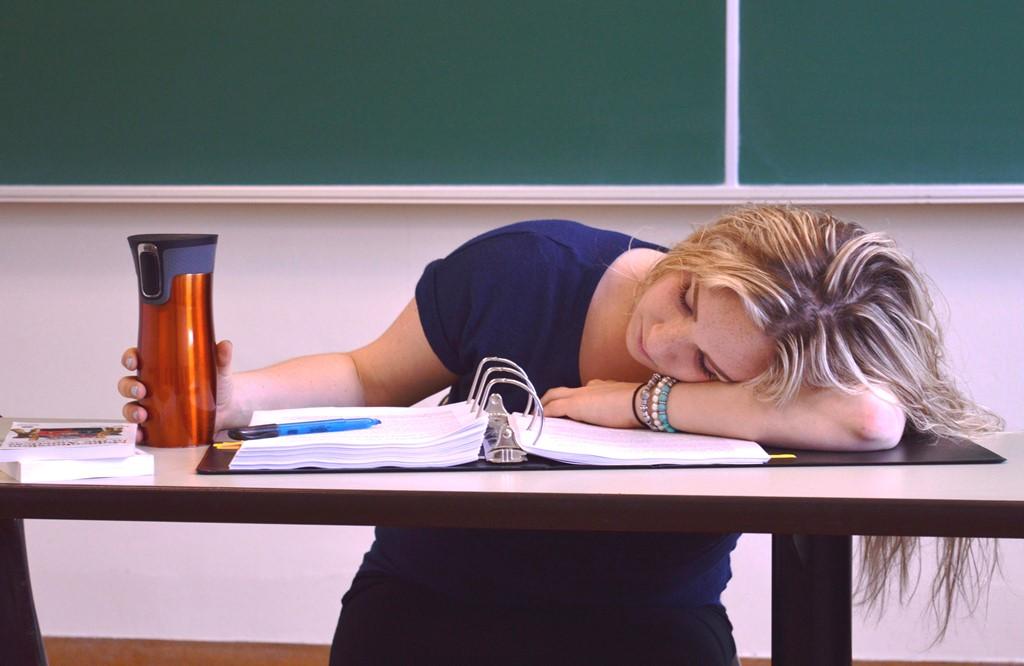 Author Alexa Shryer asleep on a desk in class