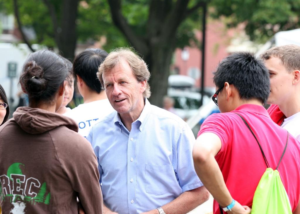 Allan Rock Speaks to students outside, on the Tabaret lawn