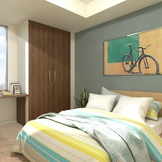 A sunny bedroom, with double bed and painting of a bicycle above the bed.