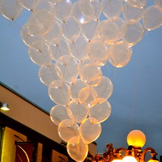 balloons floating next to a lamp post