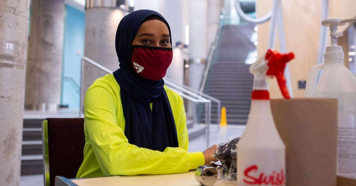 A student-ambassador at her work station
