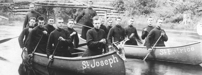 Oblates seminarian in canoes.
