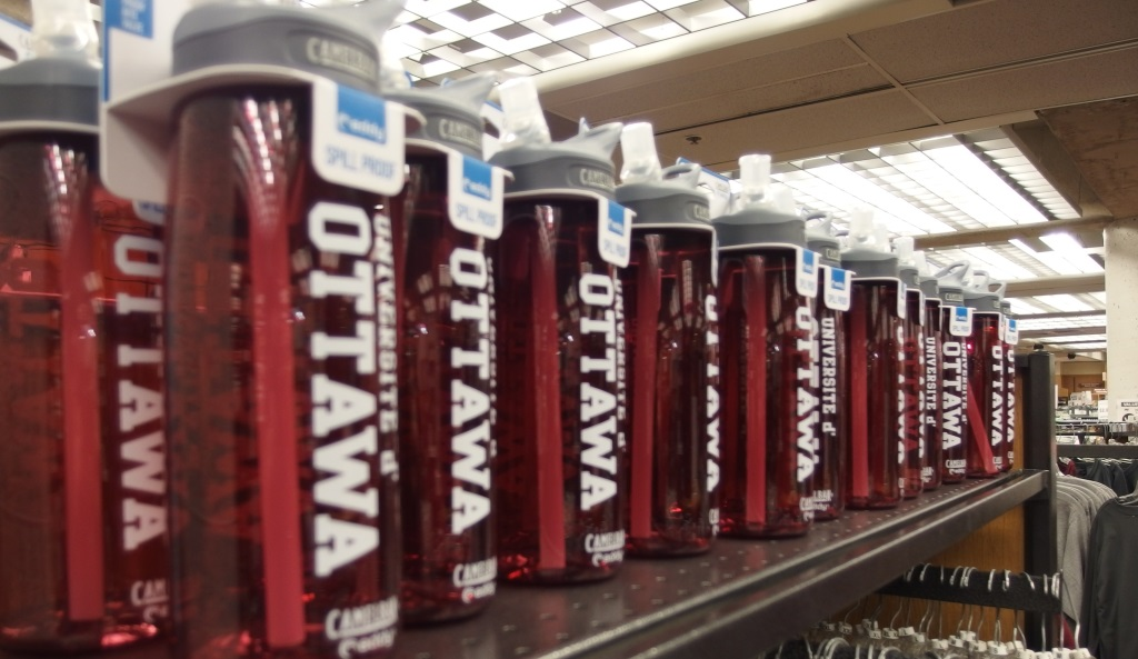 A row of uOttawa reusable water bottles
