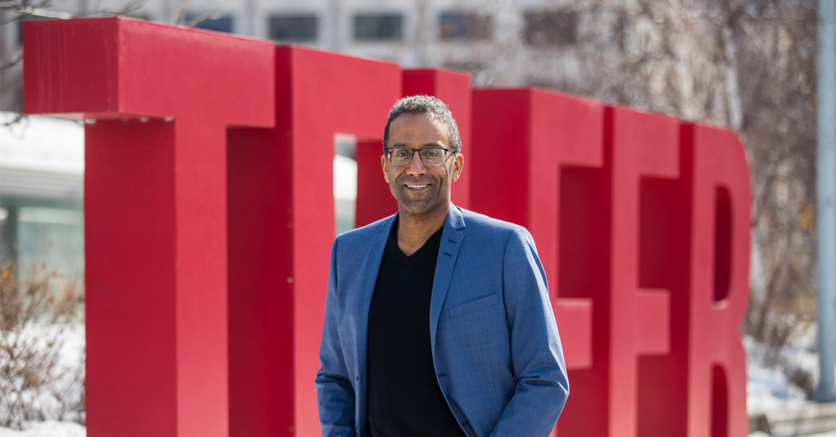 Stéphane Brutus in front of the giant red TELFER letters