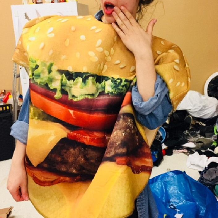 Woman wearing a hamburger costume.