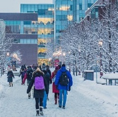 Students walk through the snowy University of Ottawa campus.