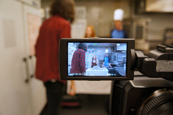 Katy Raymond and Morgan Briault during a video shoot. They are seen in the camera monitor