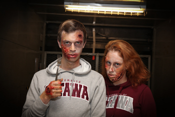 Katy Raymond and Morgan Briault are made up to look like zombies.