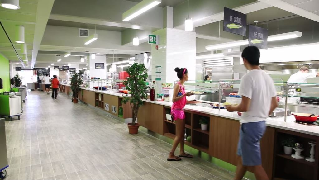 Students at the counter of the new dining room