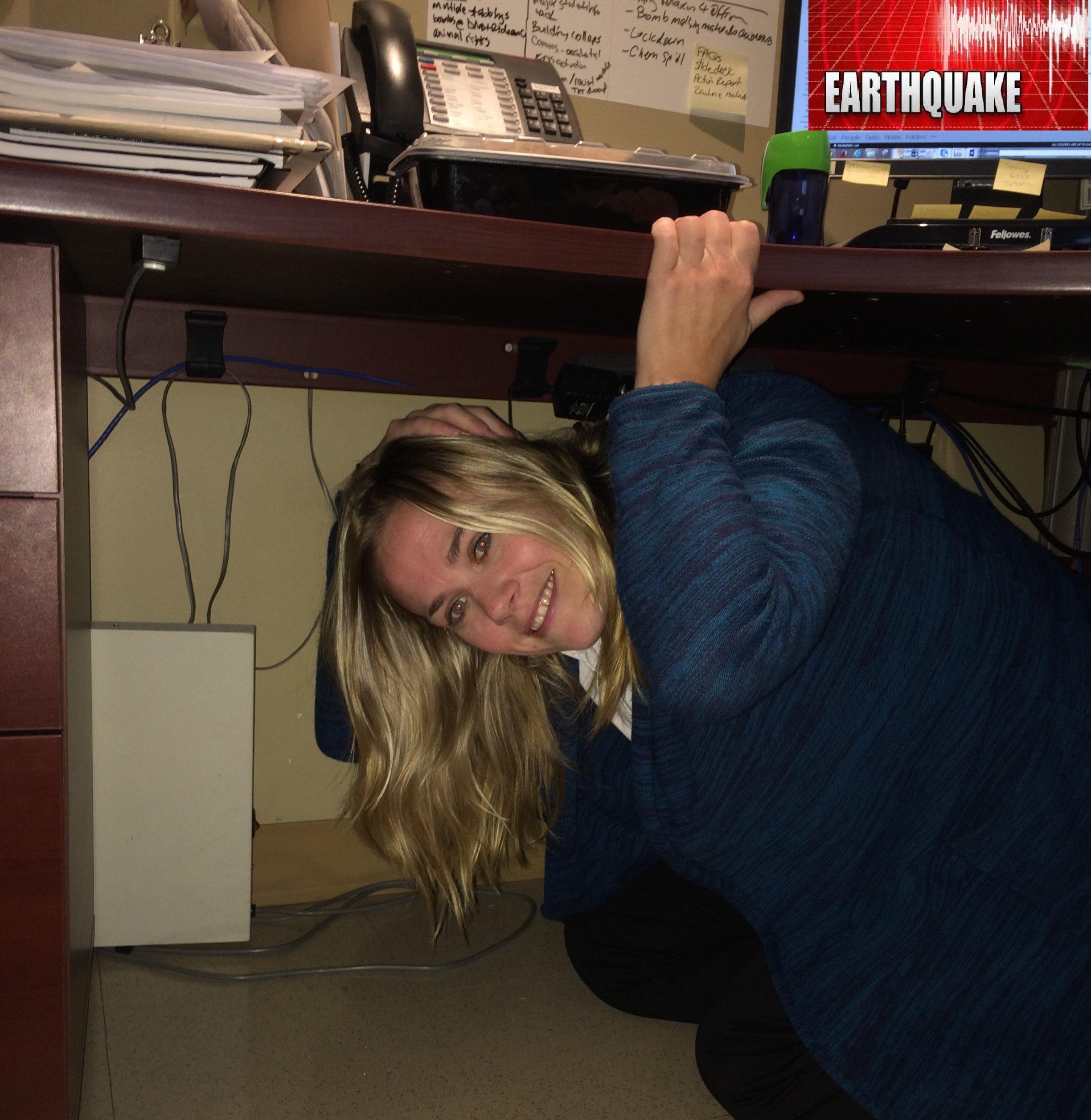 Dana Fleming, Emergency management program coordinator, under her work desk