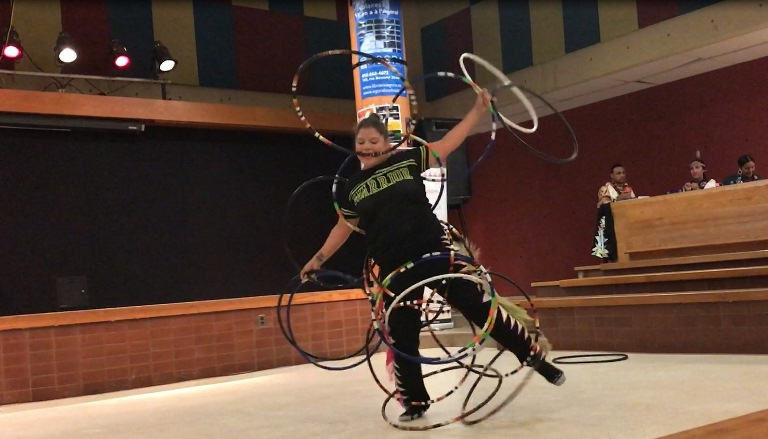 A student performs a traditional aboriginal danse.