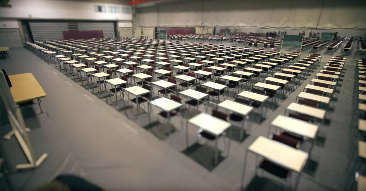 Rows of desks in an examination hall.
