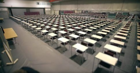 Exam room filled with empty desks