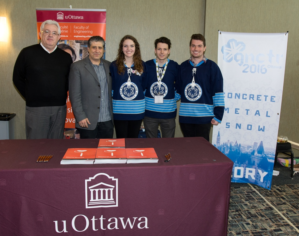 Faculty of Engineering representatives with GNCTR planning committee members standing behind the uOttawa display table.