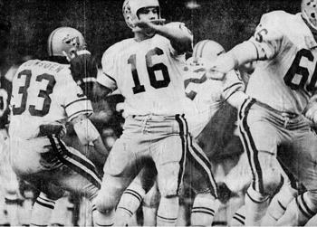 Black and white photo of a few members of the 1975 Gee-Gees football team in action on the field.