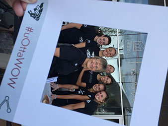 Group of seven women viewed through a picture frame bearing the #uOttaWOW hashtag