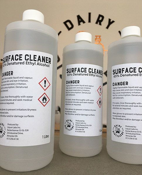 three bottles of the surface disinfectant created by Dairy Distillary