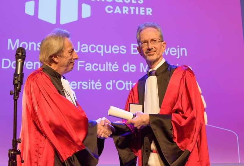 Lyon 1 President Francois-Noel Gilly gives Dr. Jacques Bradwejn an hon. doc.